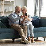 grandparents looking at phone